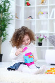 Child playing with colorful blocks — Stock Photo