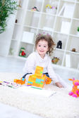 Little girl with her toys — Stock Photo