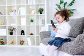 Child using mobile phone — Stock Photo