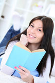 Happy young woman studying — Stock Photo