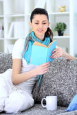 Young woman enjoying in book — ストック写真