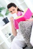 Woman with tea reading book — Stock Photo