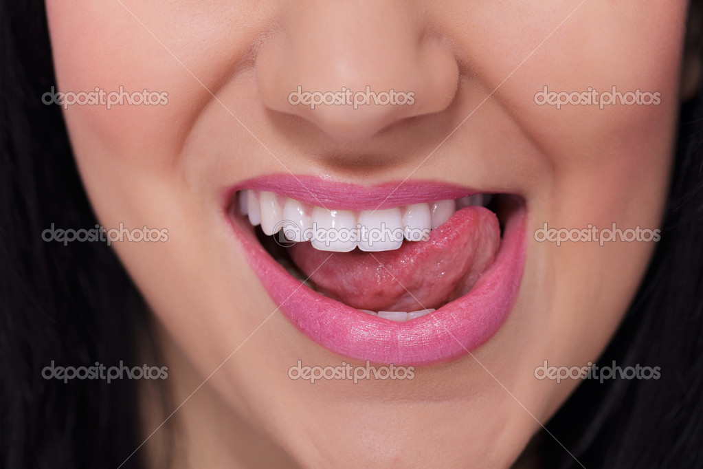 woman licking cum lips