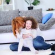Happy young mother playing with  her little daughter — Stock Photo
