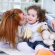 Adorable girl and mother at home - Foto Stock