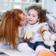 Adorable girl and mother at home - 