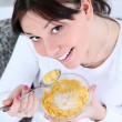 Royalty-Free Stock Photo: Woman eating cornflakes