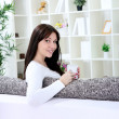 Woman holding a cup of coffee and smiling — Stock Photo