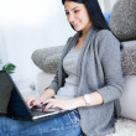 Smiling woman typing on laptop — Stock Photo #9919574
