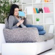 Relaxing woman with smart phone — Stockfoto