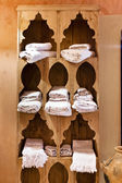 Wooden shelve with towels — Stock Photo
