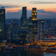 Sunset Over Singapore City Skyline - Stock Photo