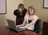 Two businesswomen working on a computer — Stock Photo