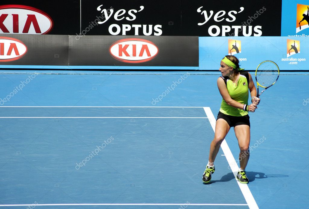 MELBOURNE, AUSTRALIA - JANUARY 21, 2012: WTA world number 27 tennis player Svetlana Kuznetsova waits to hit a backhand to Sabine Lisicki at Hisense Arena in the 2012 Australian Open, in Melbourne Australia January 21, 2012. Lisicki defeated Svetlana   Stock Photo #9538747