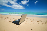 Laptop on the beach — Stock Photo