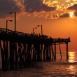 Fishermen at sunrise on a fishing pier in North Carolina — Stok fotoğraf