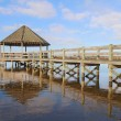 Gazebo, dock, blue sky and clouds over calm sound waters - Stock Photo