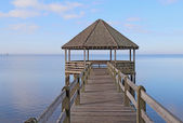 Gazebo and dock over calm sound waters — Stock Photo