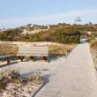 Walkway, dunes and buildings at Asilomar State Park and Conferen — Stock Photo