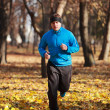 Man running in the forest — Stock Photo