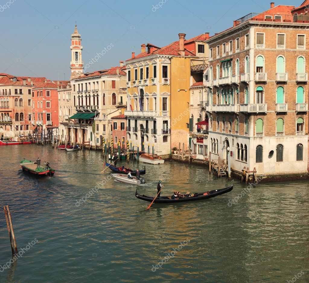 Venice,Italy,February 25th: Two gondolas and two motorboats navigate on the Canal Grande in the late afternoon in Venice during the carnival days. — Stock Photo #9014485