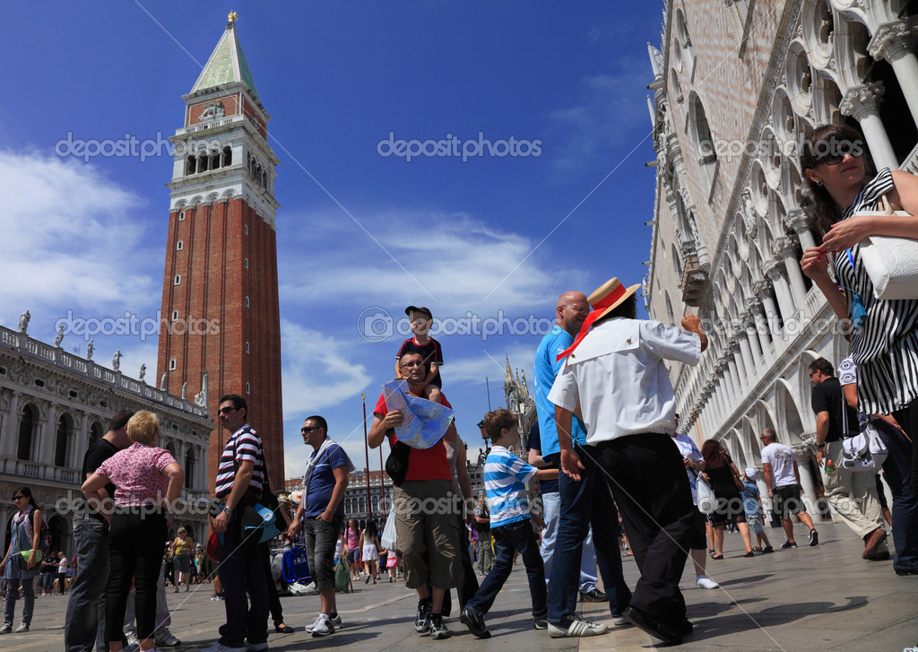 Venice,Italy,July 28th, 2011: Low angle view of in various situation in St. Marco Square in Venice. Piazza San Marco is the main public square in Venice.  Stock Photo #9027276