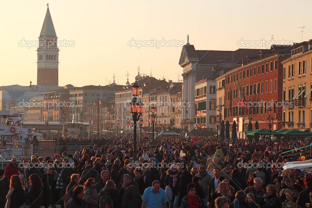 Venice, Italy- February 26th, 2011: Image of crowd of tourists walking in the evening in Sestiere Castello in Venice. Sestiere Castello (The Castello District).  Stock Photo #9047086