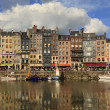 The colourful Honfleur harbour - Stock Photo