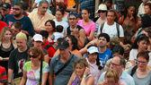 Crowd of tourists — Stock Photo