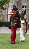 Troubadours on stilts — Stock Photo
