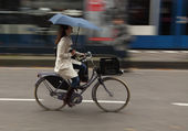 Woman on bicycle — Stock Photo
