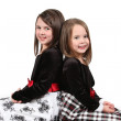 Adorable little sisters isolated on white background — Foto Stock