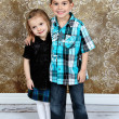 Adorable little brother and Sister on studio background - Стоковая фотография