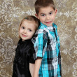 Adorable little brother and Sister on studio background — Stock Photo