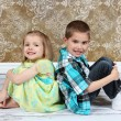 Adorable little brother and Sister on studio background - Stock Photo