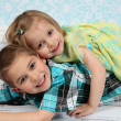 Adorable little brother and Sister on studio background — Stock Photo #8931713
