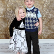 Adorable little brother and Sister on studio background — Stock Photo #8931879