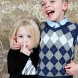 Adorable little brother and Sister having fun on studio background — Stock Photo #8931881