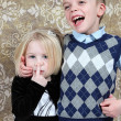 Adorable little brother and Sister having fun on studio background — Stock Photo
