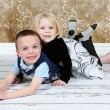 Adorable little brother and Sister on studio background — Stock Photo #8931886