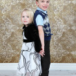 Adorable little brother and Sister on studio background — Stock Photo #8931893