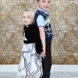 Stock Photo: Adorable little brother and Sister on studio background