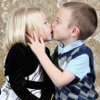 Adorable little brother and Sister having fun on studio background — Stock Photo #8931896