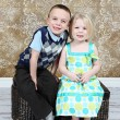 Adorable little brother and Sister on studio background — Stock Photo #8931898
