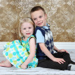 Adorable little brother and Sister on studio background — Stock Photo #8931901