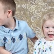 Adorable little brother and Sister having fun on studio background — Stock Photo #8931903