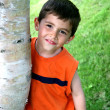 Boy hanging out around Tree — Stock Photo #8999811