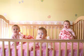 Baby Girls in Crib - Triplets — Stock Photo
