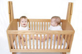 Baby Twins in Crib — Stock Photo