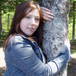 Stock Photo: Woman posing by Tree 2